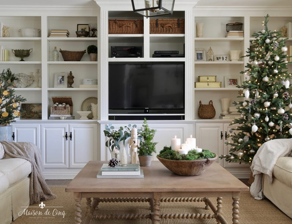 French farmhouse family room decorated for Christmas neutral palette of silver and white