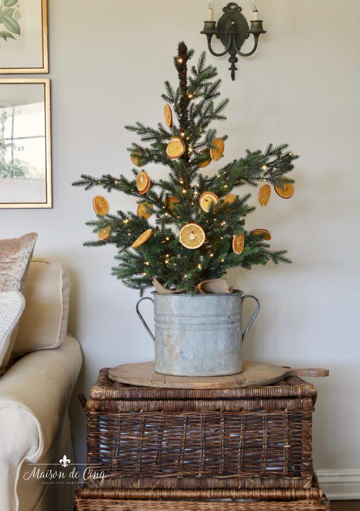cute tabletop tree with dried orange garland Scandinavian European Christmas inspired decor