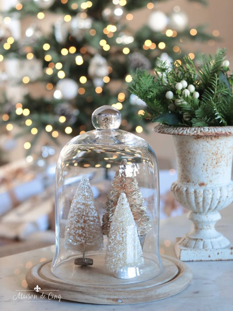 Christmas vignette with bottle brush trees in cloche and French urn