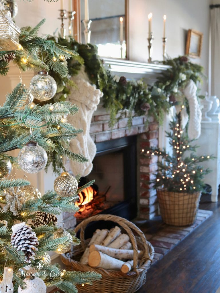 gorgeous Christmas mantel with garland and knit stockings in French country living room