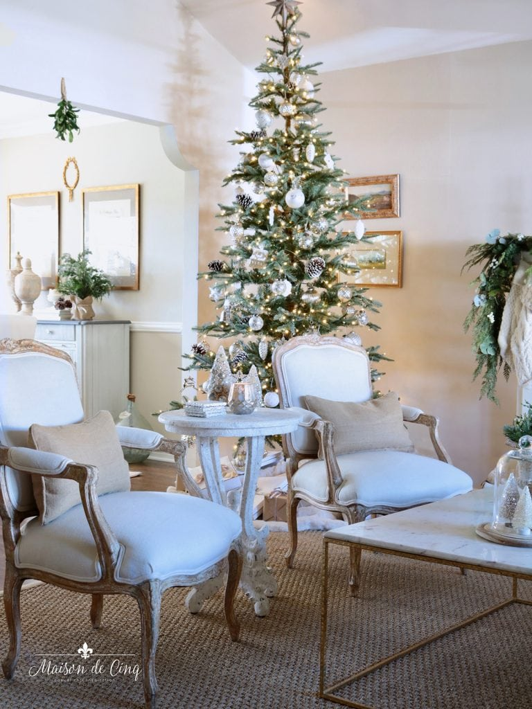 gorgeous French farmhouse Christmas holiday decorating tree french chairs neutral living room