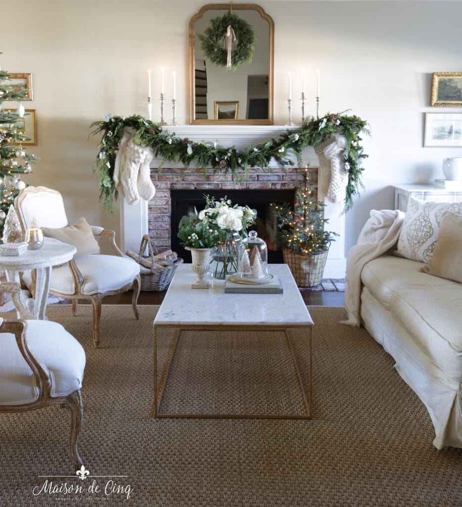neutral French Christmas decorating living room with mirror wreath and garland