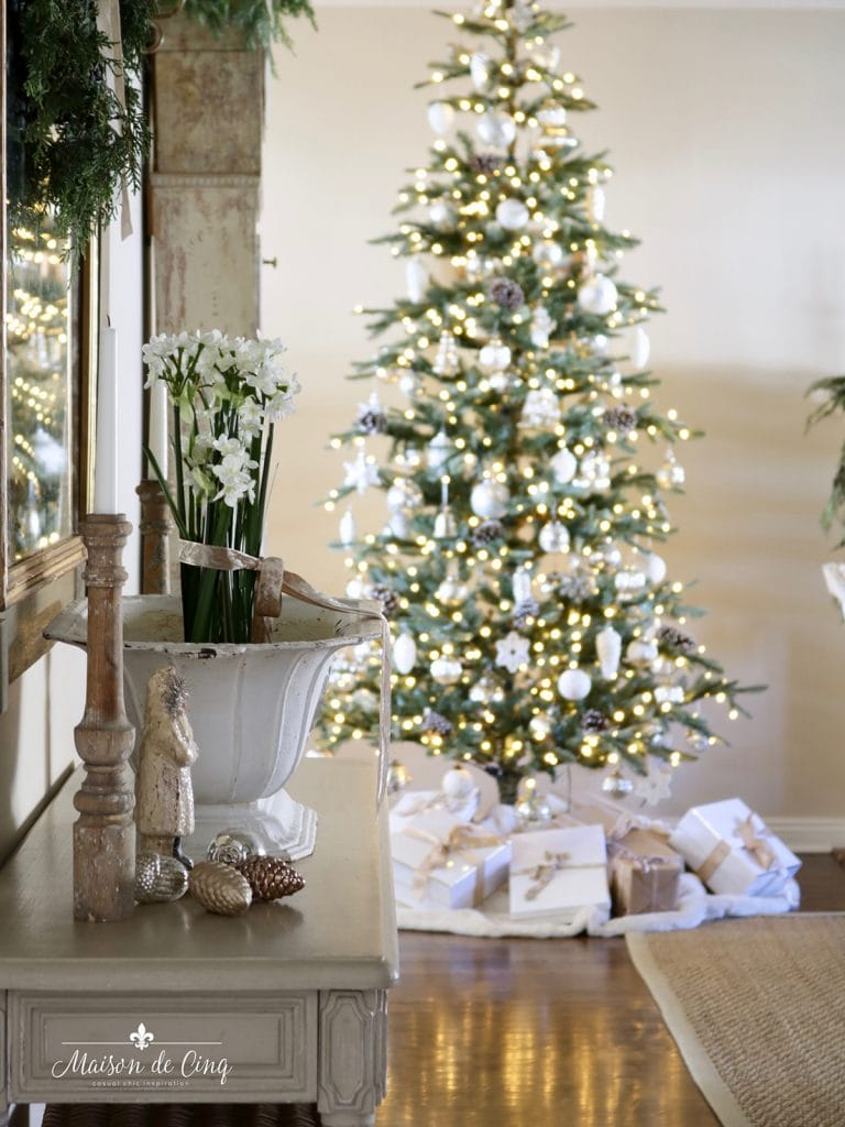 French farmhouse inspired Christmas tree and paper whites in neutral living room