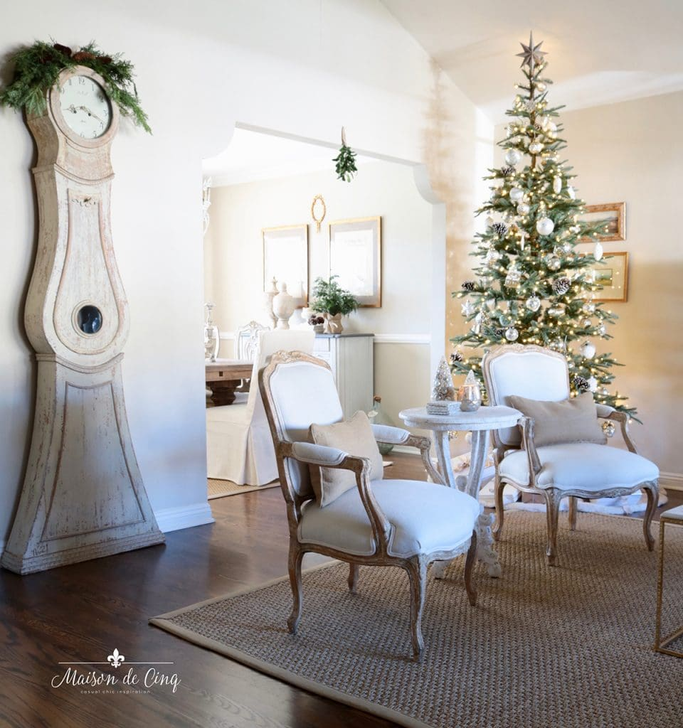 French country living room with Christmas tree and Mora clock Swedish decor