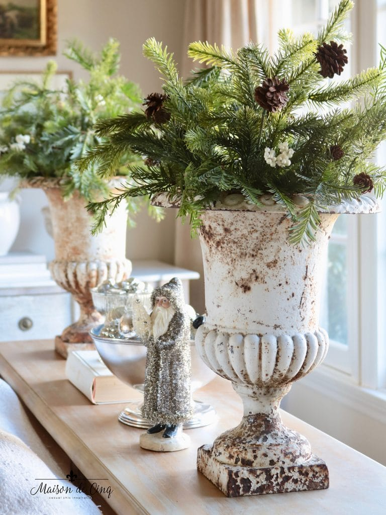greenery in French urns Christmas decorating idea