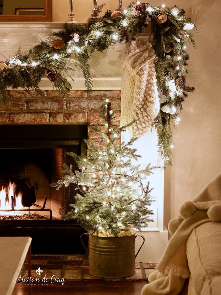 little tree with twinkle lights by the fire garland French country decor
