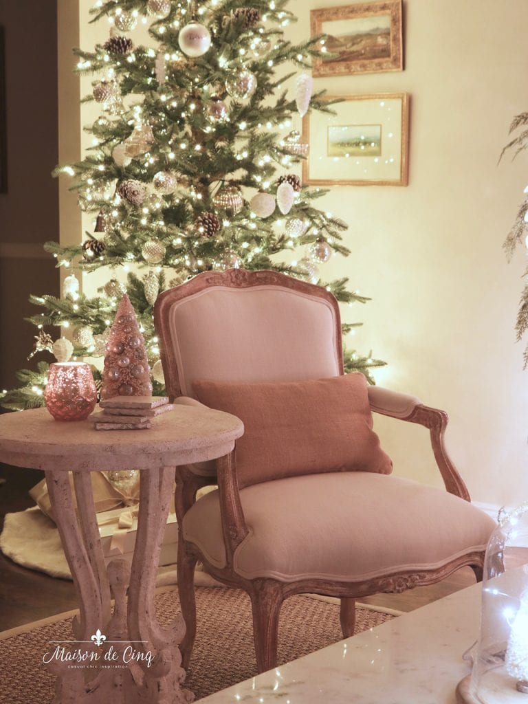 cozy candlelight Christmas tree with white lights French chair side table