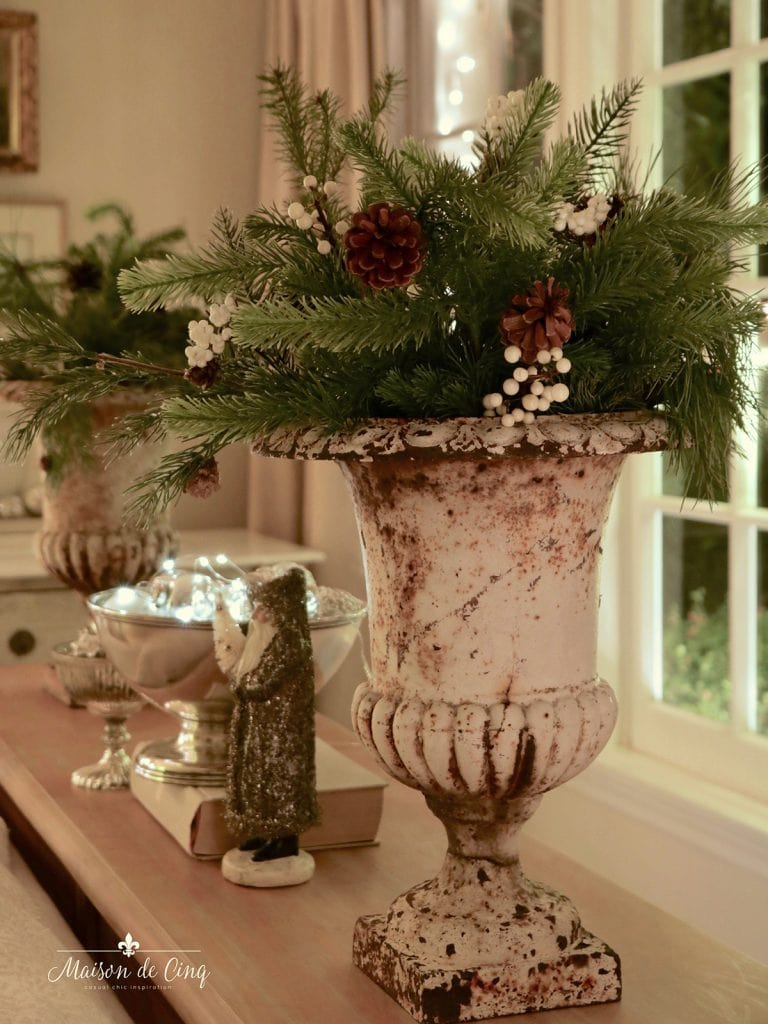 gorgeous French antique urn with greenery twinkle lights Christmas decor