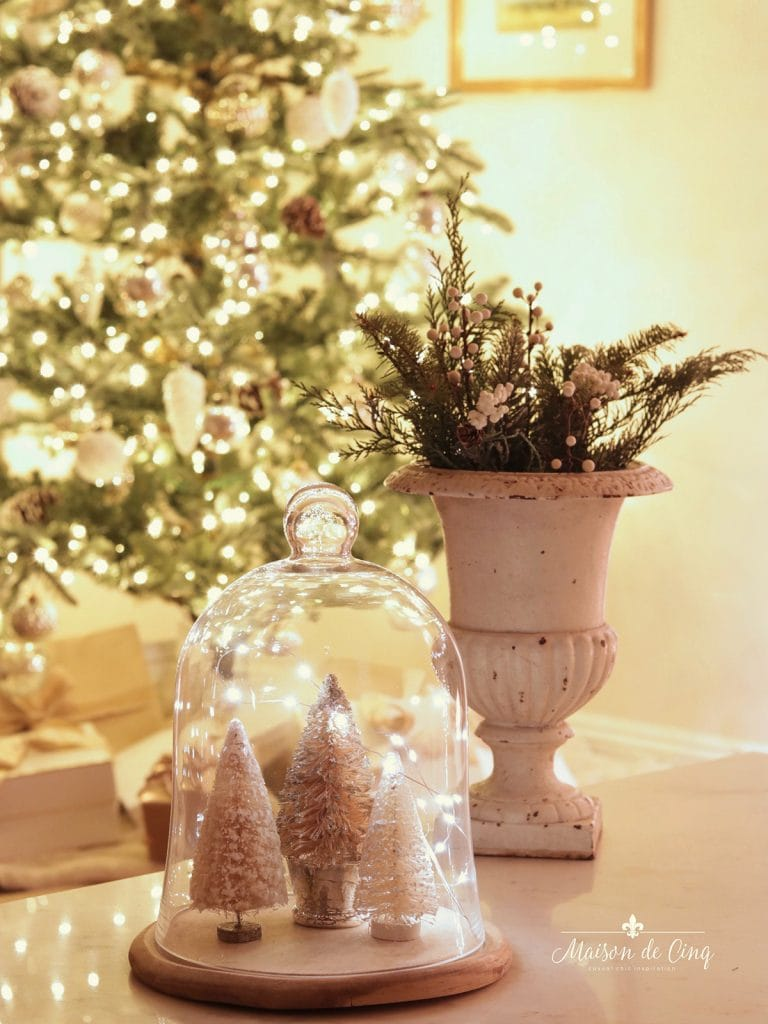 holiday decorating ideas gorgeous French farmhouse vignette with urn and trees under glass cloche