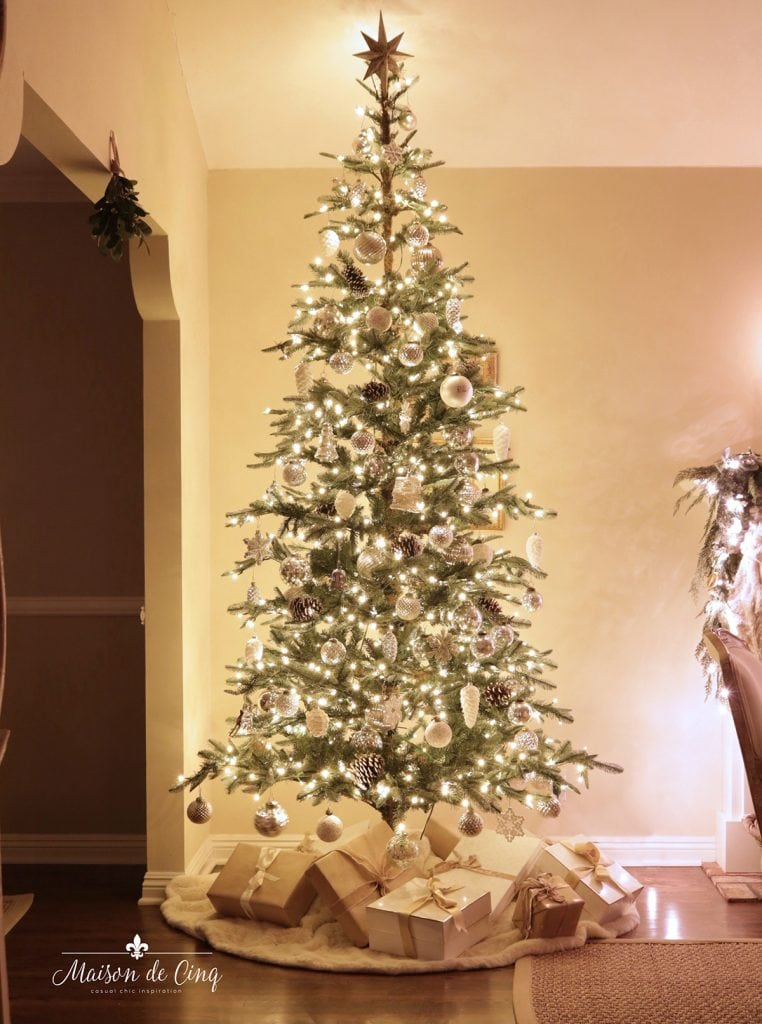 Gorgeous Christmas tree with white and neutral ornaments twinkle lights star French country living room