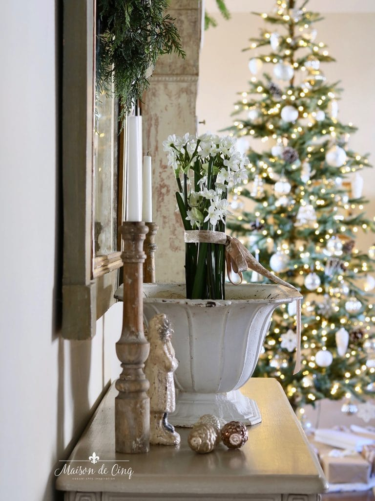 gorgeous entry way with paper whites in French urn Christmas tree holiday decor
