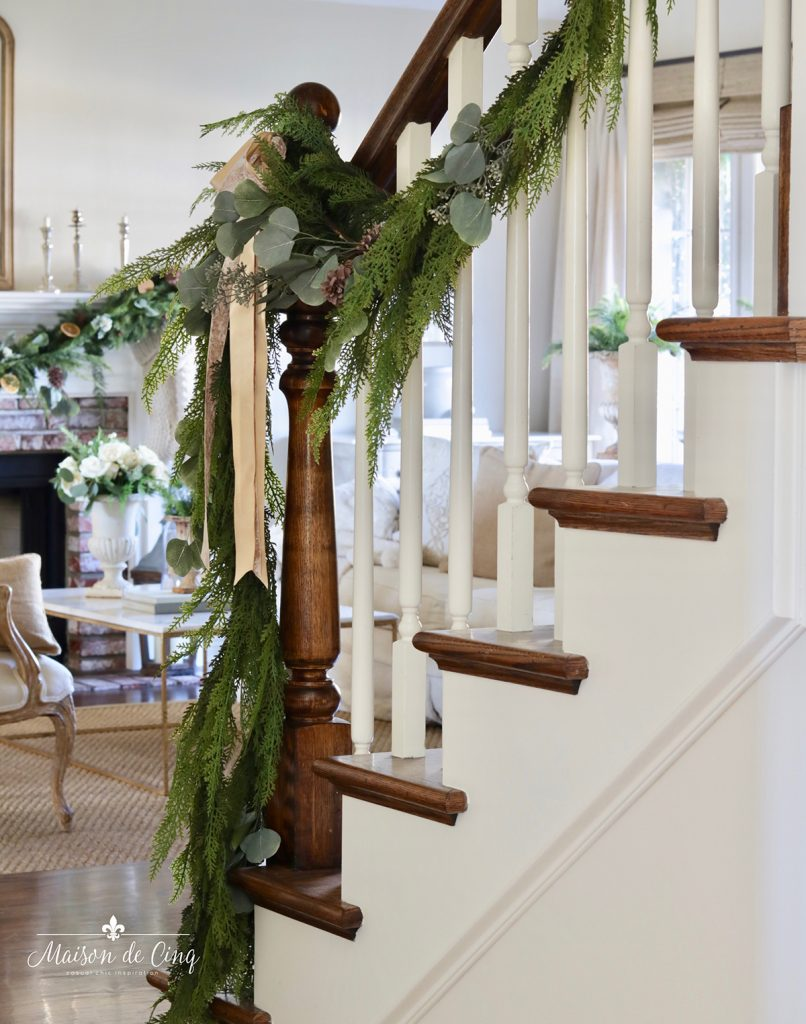 garland on stairwell in French country living room holiday decorating