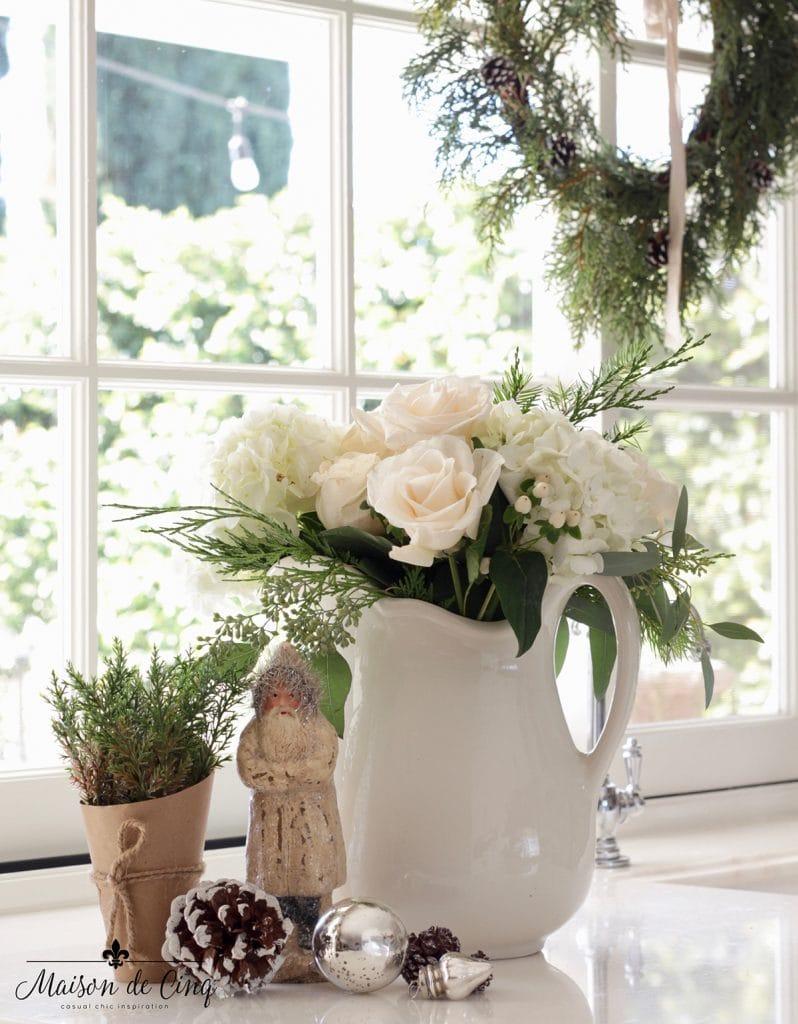 kitchen counter vignette white roses vintage santa pine cones Christmas decorating idea