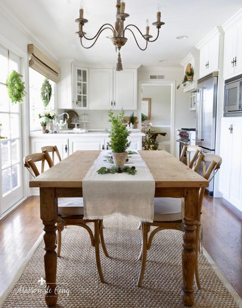 French farmhouse inspired Christmas kitchen farmhouse table pine trees runner