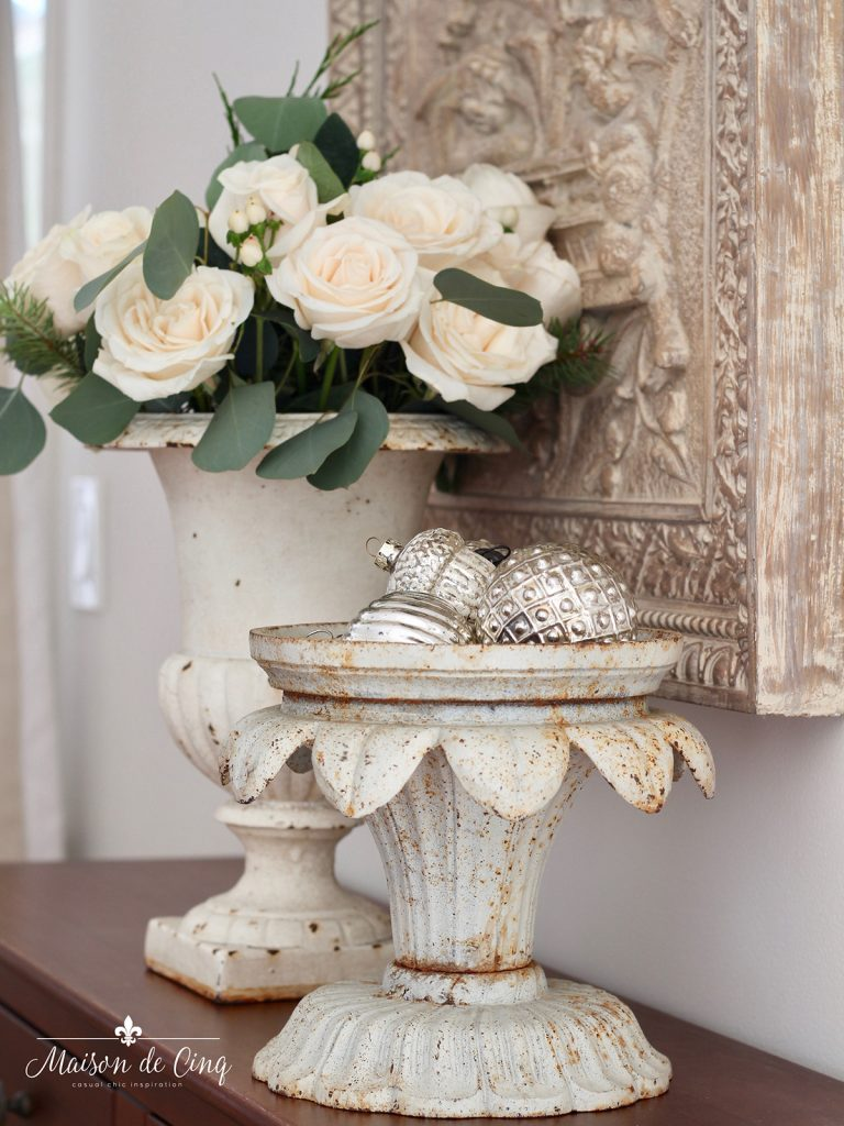 gorgeous Christmas vignette decorating idea ornaments in urn with white roses