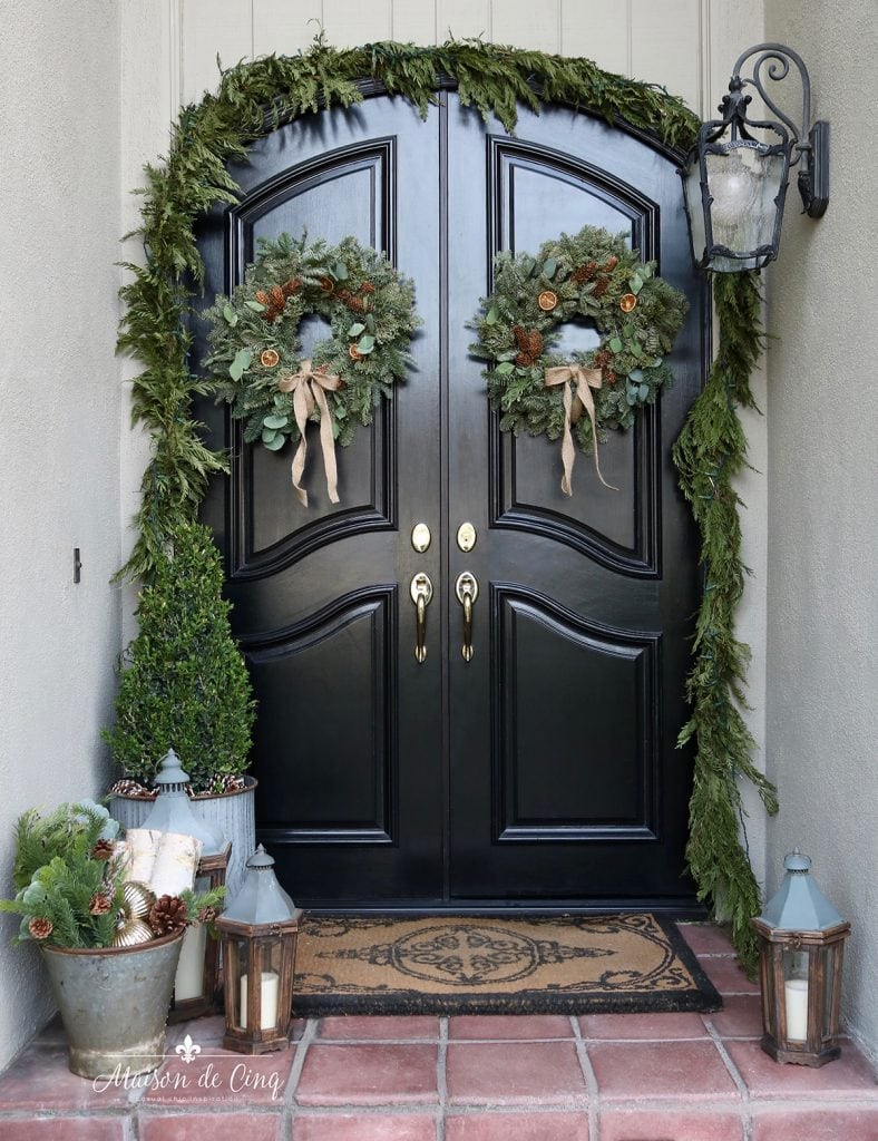 gorgeous holiday front porch black doors wreaths garland classic christmas decor