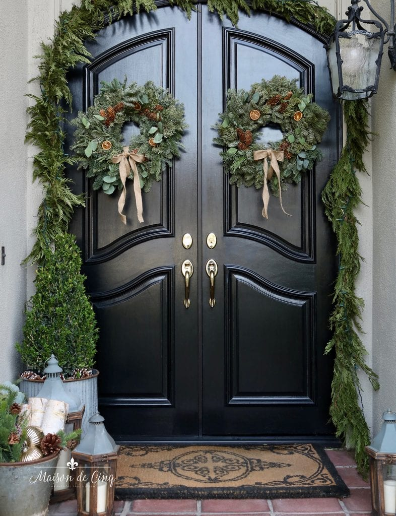 gorgeous and simple holiday decorating on the porch wreaths and garland