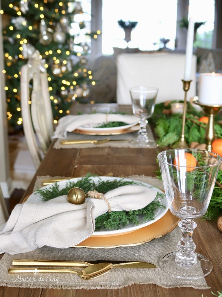 gorgeous cozy holiday tablescape European style with greenery and oranges