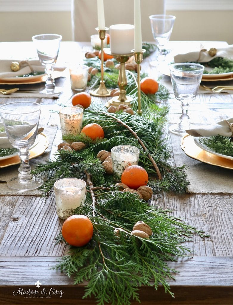 cozy holiday tablescape with oranges walnuts brass candlesticks and mercury glass votives gorgeous Christmas table