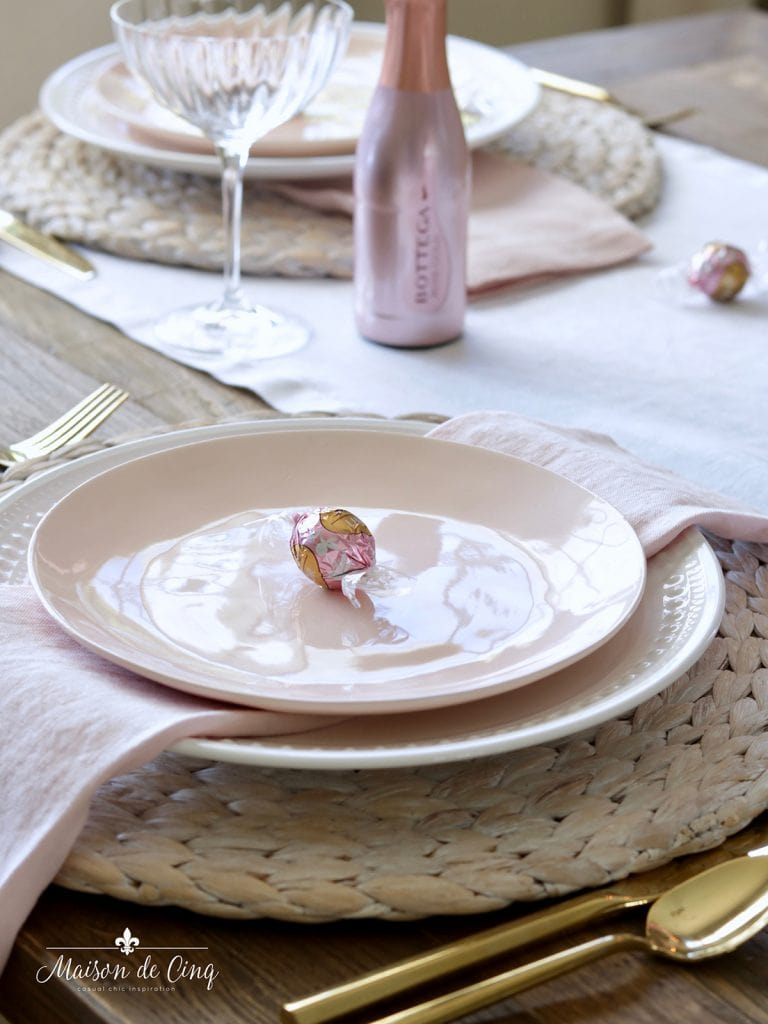 pink salad plate over white dinner plate with pink linen napkin pretty table setting ideas