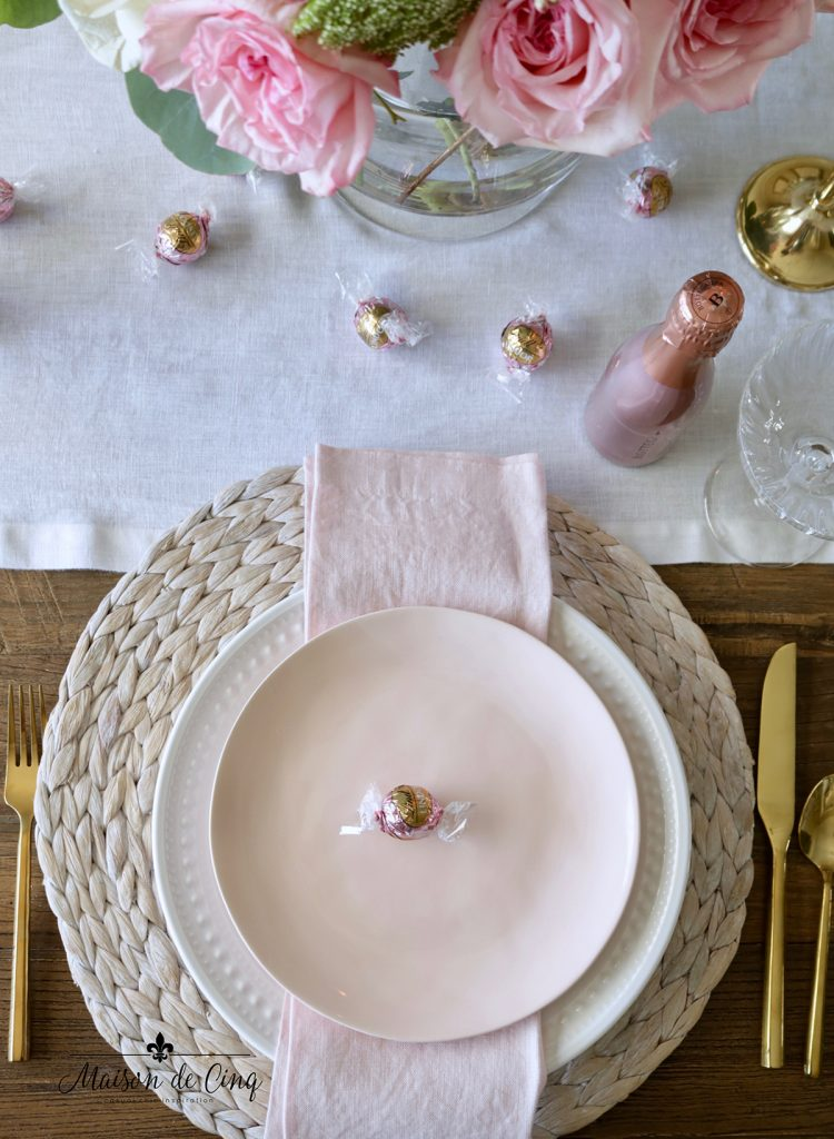 gorgeous Valentine's day tablescape ideas with pink flowers pink salad plate and white dinner plate