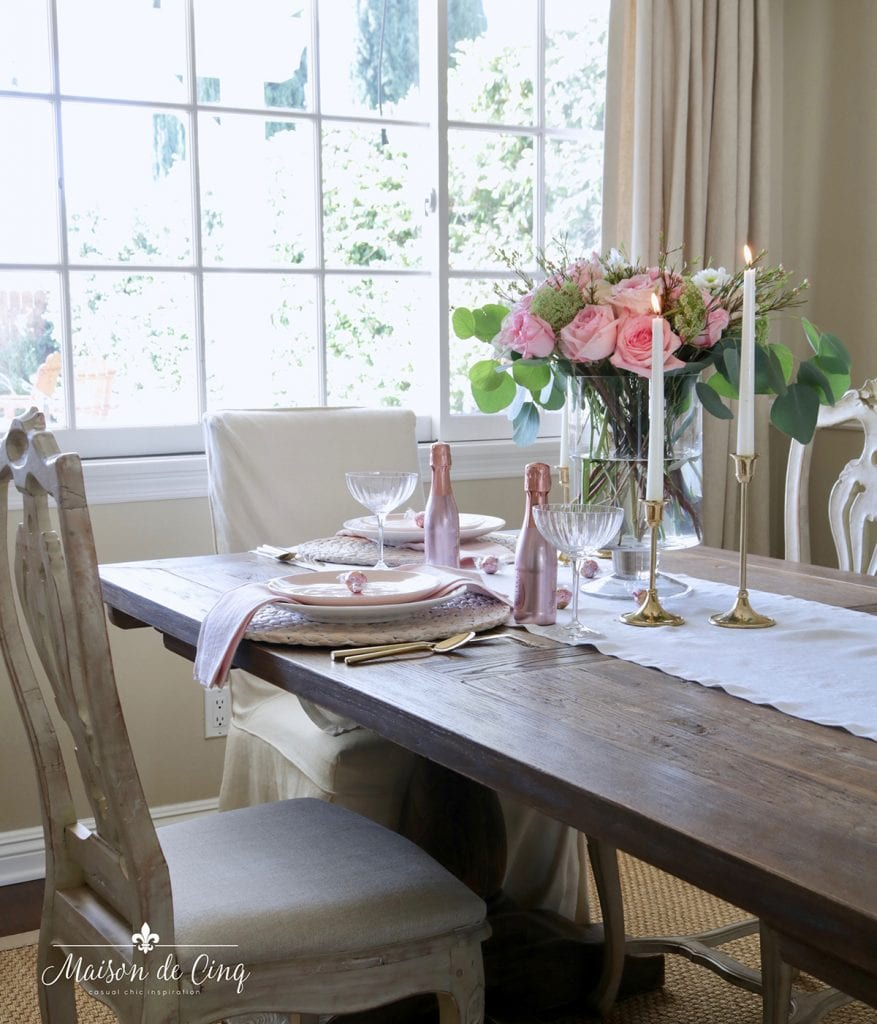 romantic table setting Valentine's day pink flowers white runner farmhouse table