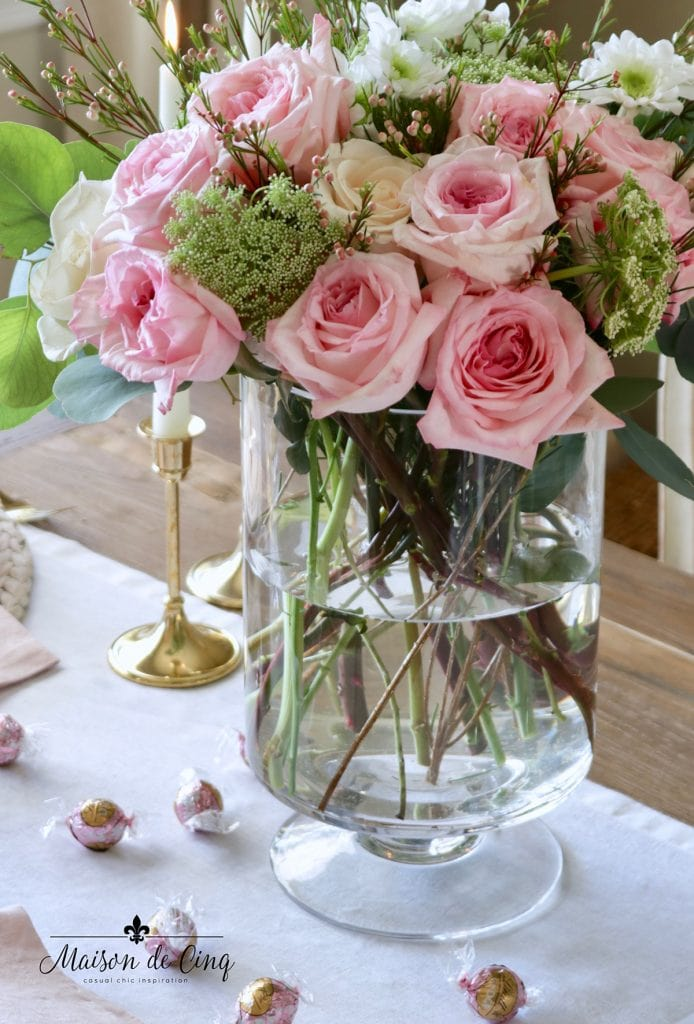 gorgeous pink roses with white flowers in vase table setting Valentine's day tablescape
