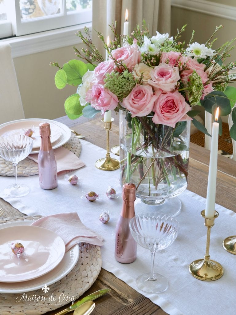 gorgeous pink roses brass candlesticks romantic table setting