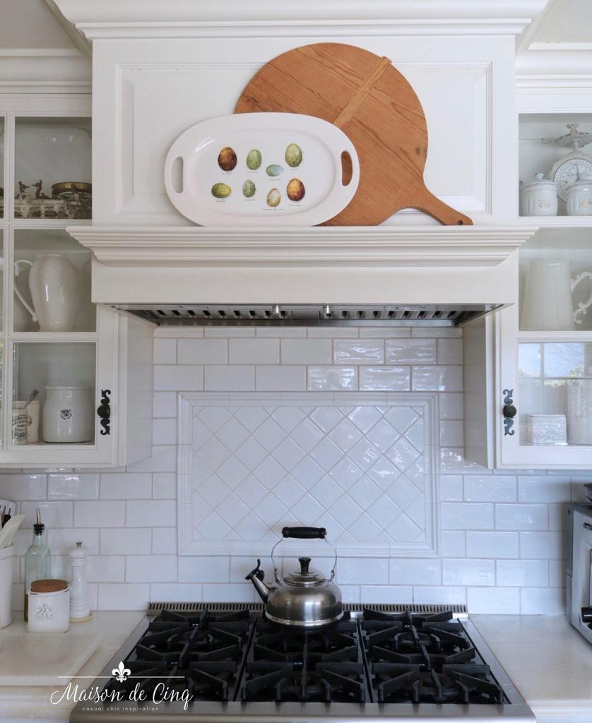 egg platter spring decor on range mantel in white French country kitchen