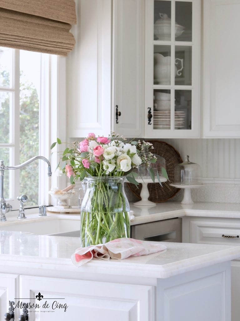 lovely pink and white flowers in French country white kitchen gorgeous spring decor