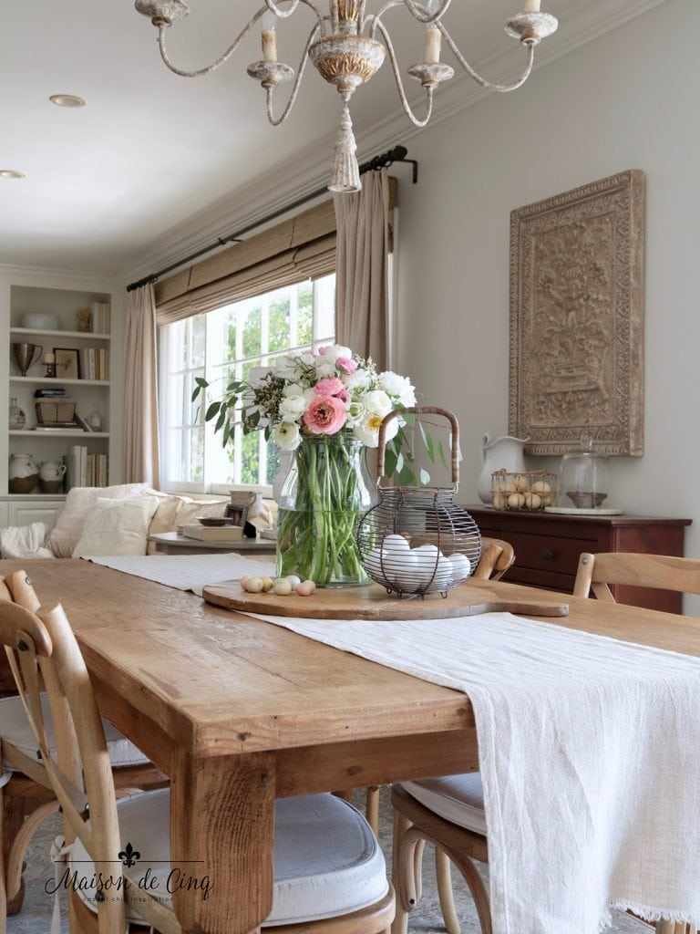 French farmhouse style dining area flowers eggs spring decor