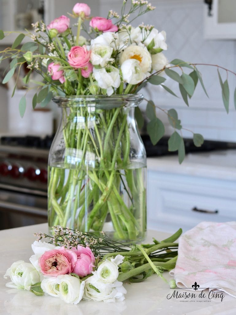 pink and white flowers in glass vase spring kitchen decorating ideas