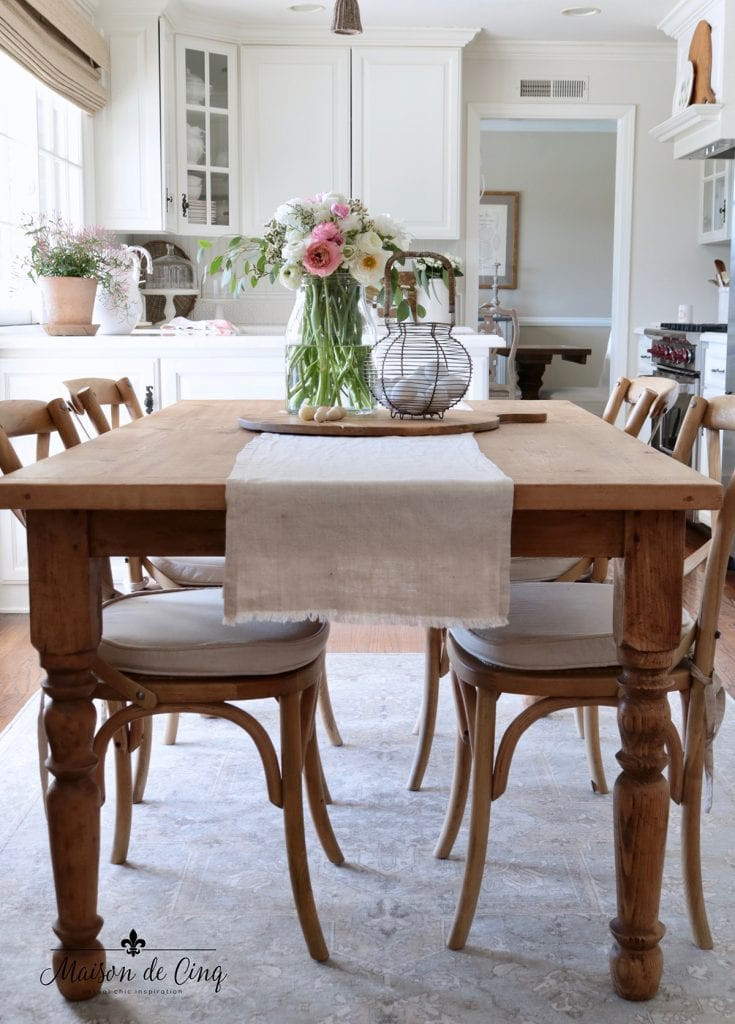gorgeous French farmhouse kitchen dining table pink and white flowers spring decor ideas