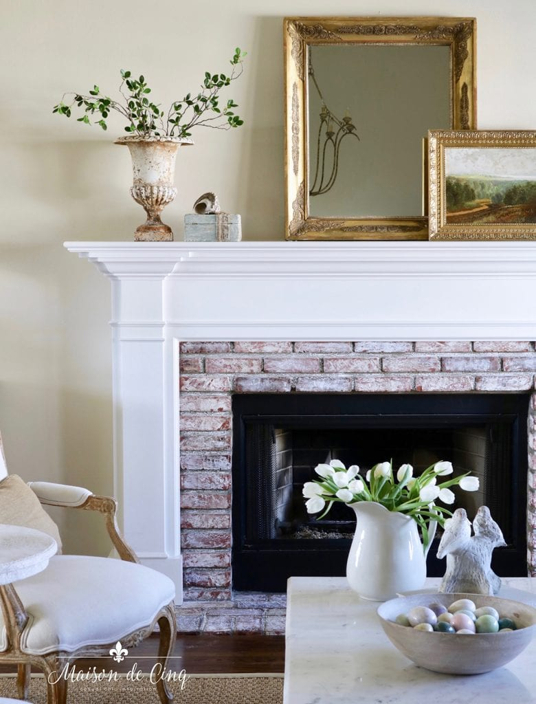 simple spring decorating ideas for living room mantel with spring branches tulips gold mirror