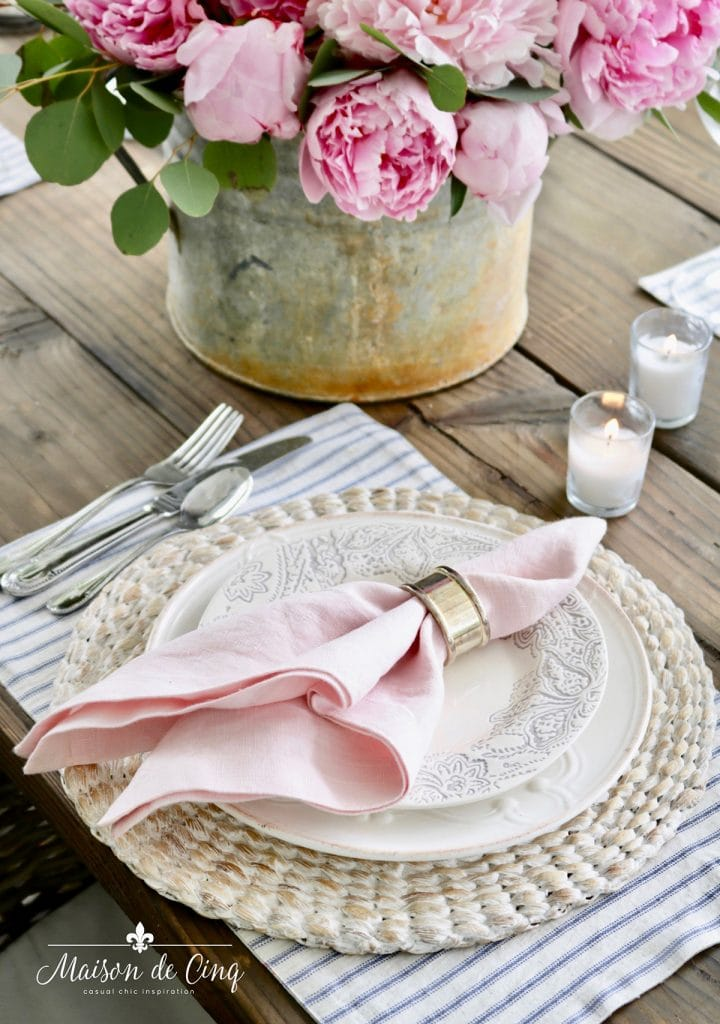 spring table decor idea blue and pink with peonies and candles