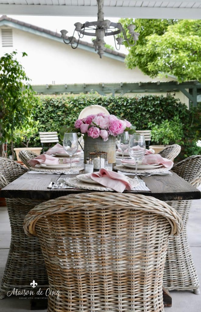 gorgeous outdoor spring table setting with pink peonies French country setting patio dining