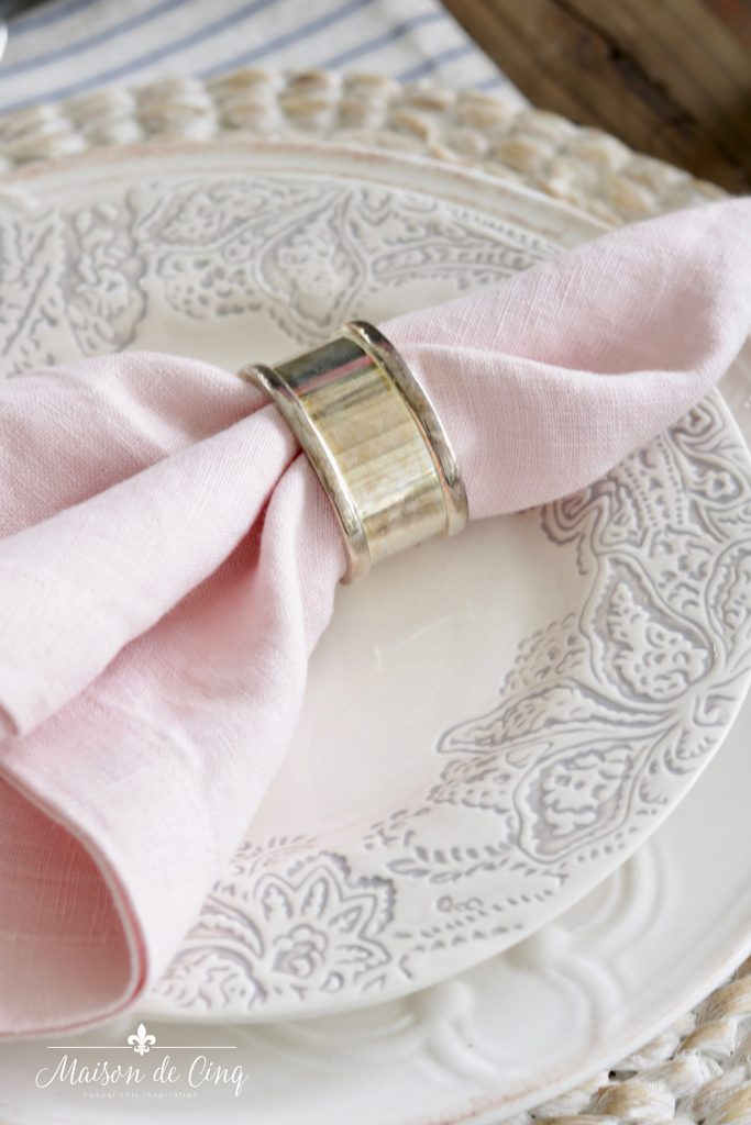 pink linen napkin with silver napkin ring on blue and white plate spring table setting ideas