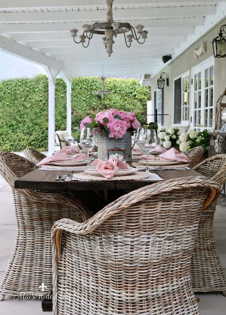 gorgeous spring table decor French country style farmhouse table and wicker chairs