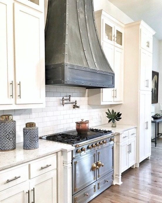 gorgeous zinc range hood with la cornue stove in white modern farmhouse kitchen