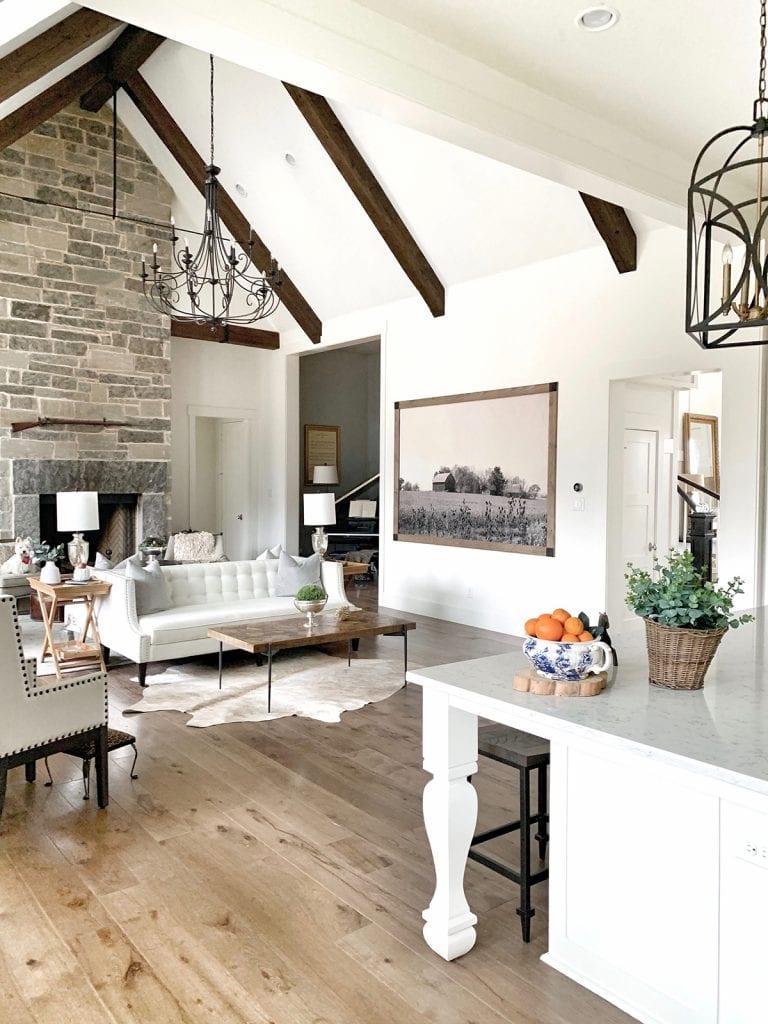 modern Texas farmhouse white walls wood beams and wood floors gorgeous family room