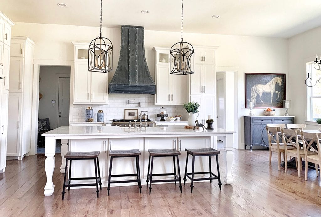 modern farmhouse white kitchen with lanterns and large island