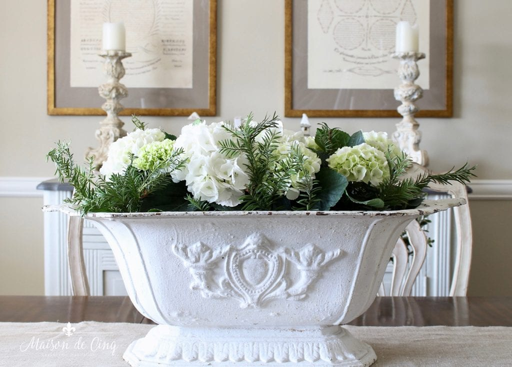 hydrangeas in French cast iron urn gorgeous French country dining room