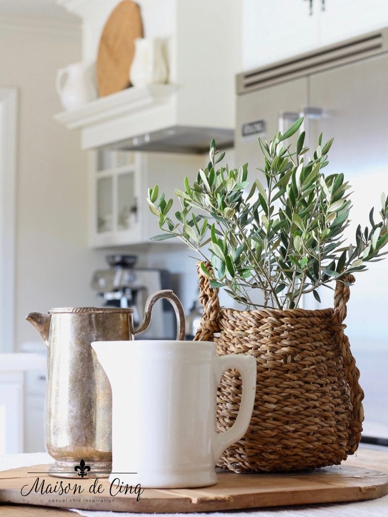 olive plant in basket in kitchen decorating with houseplants ideas