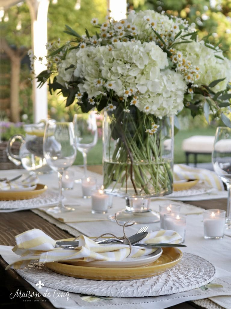 gorgeous summer flowers on yellow and white summer tablescape