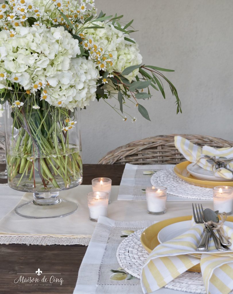 cheerful yellow summer table setting with white hydrangeas