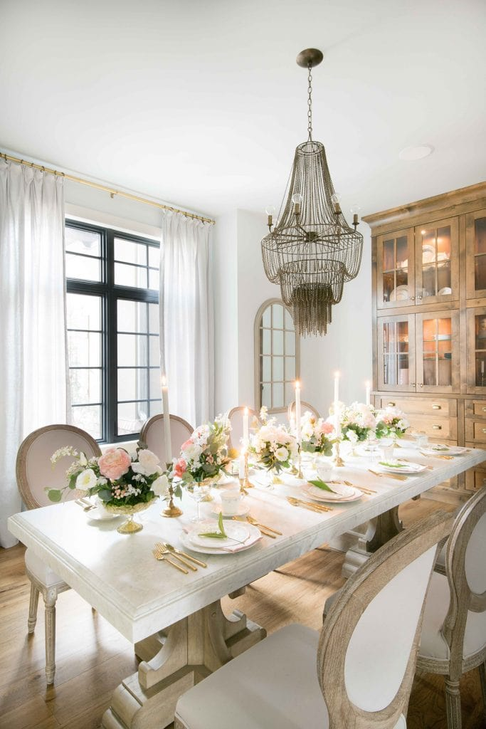 French style home with marble dining table and stunning chandelier