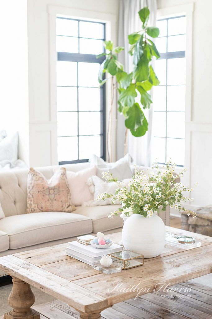 French style home with pretty soft colors farmhouse coffee table and sofa with pillows