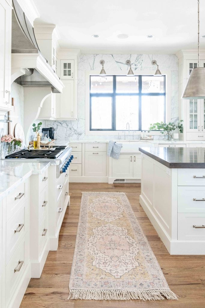 French country white kitchen with marble walls zinc hood