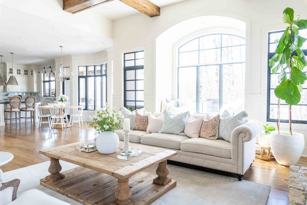 gorgeous French country style living room with farmhouse coffee table and wood ceiling beams