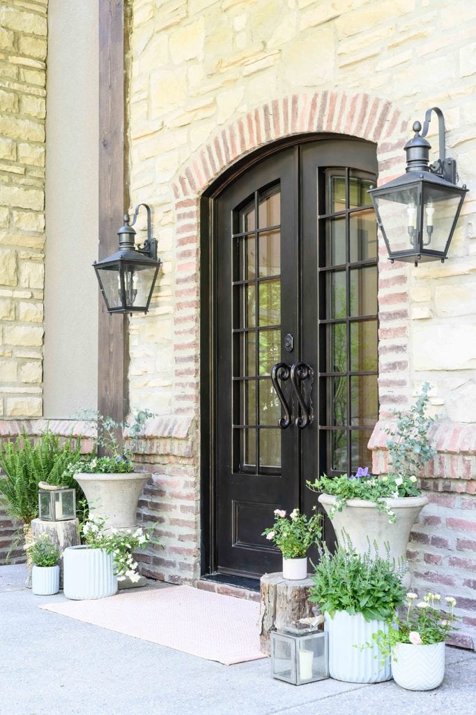 French country front door and porch with French doors and lanterns